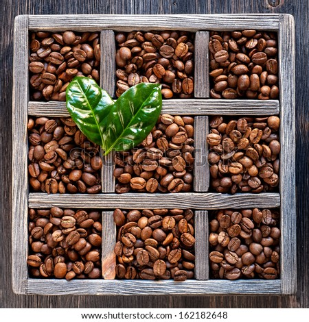 Roasted coffee beans in an old wooden box. Collage
