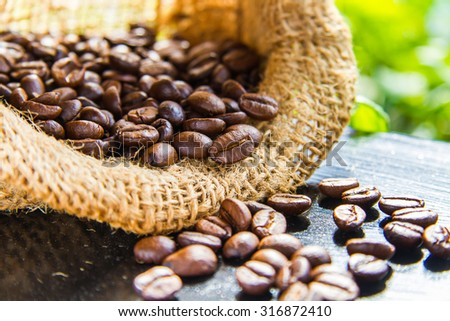 Roasted coffee beans in burlap bags of coffee and delicious. - stock photo