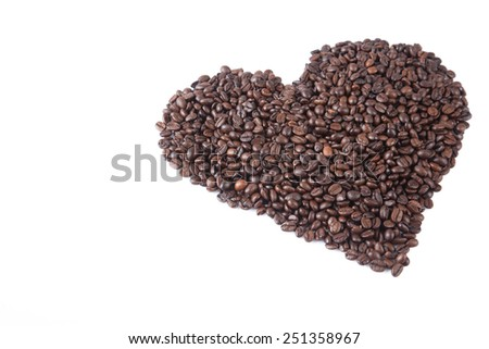 Roasted coffee beans in heart shape  on white background