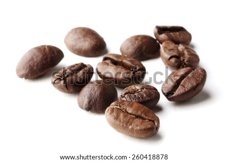 Roasted coffee beans isolated on white background close-up - stock photo