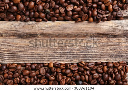 Roasted coffee beans on a brown wooden background - stock photo