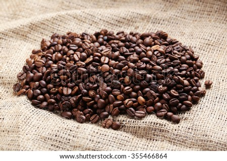 Roasted coffee beans on a sack, close up