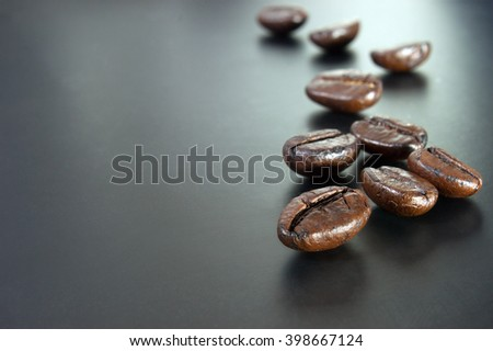 roasted coffee beans on background