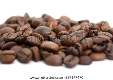 Roasted coffee beans on white background.shallow dof