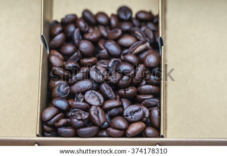 Roasted coffee beans pack cartons.