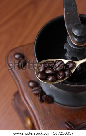 Roasted coffee beans with coffee grinder.
