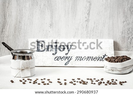 Roasted coffee beans with pitcher for making coffee