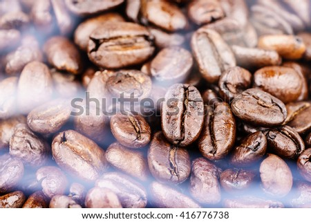 Roasted coffee beans with the smoke