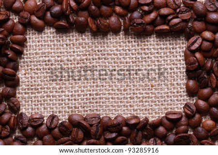 Roasted coffee frame beans on linen sackcloth - stock photo