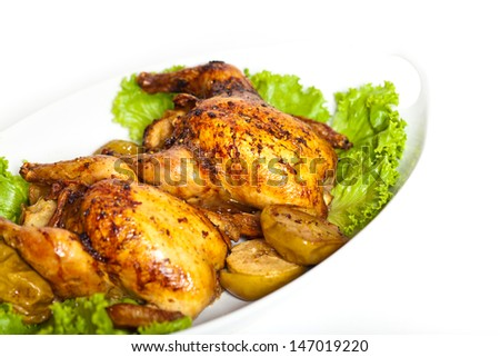 Roasted Cornish Hen chicken with apples - stock photo