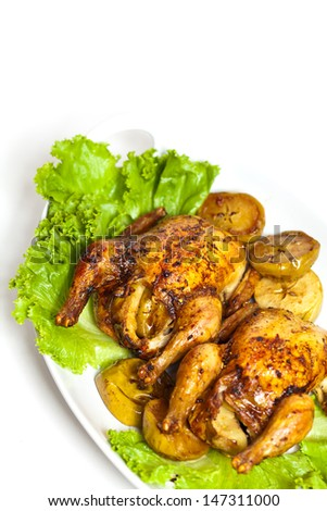 Roasted Cornish Hen with apples - stock photo
