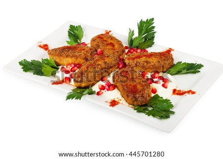 Roasted cutlets on a plate, isolated on a white background