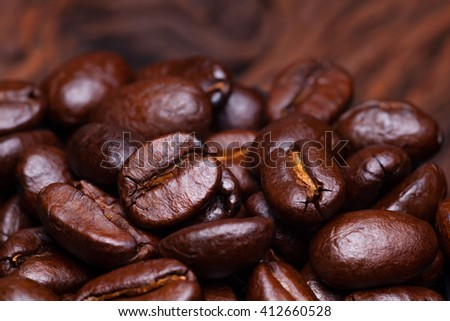 Roasted detailed tasty coffee beans with blurry background.