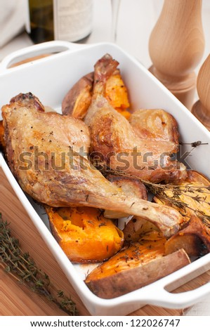Roasted duck legs with vegetables vertical