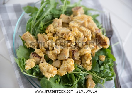 Roasted dumplings with egg and salad  - stock photo