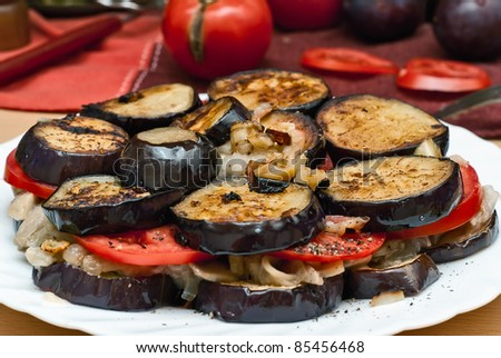 roasted eggplant and mushrooms with diced fresh tomato slices and arranged in stacks - stock photo