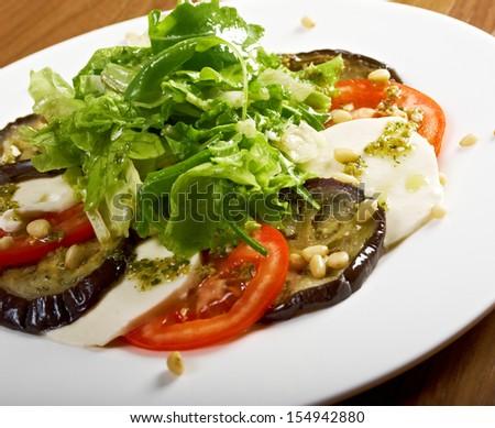 roasted eggplant with tomatoes.shallow DOF - stock photo