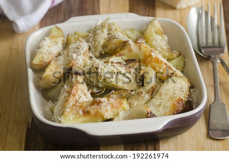 Roasted fennel, onion and potatoes with Parmesan - stock photo