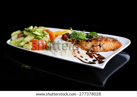 roasted fish,  rice  and vegetables on dish