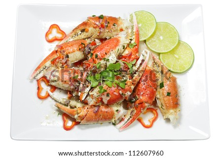 Roasted garlic crab on plate isolated over white - stock photo