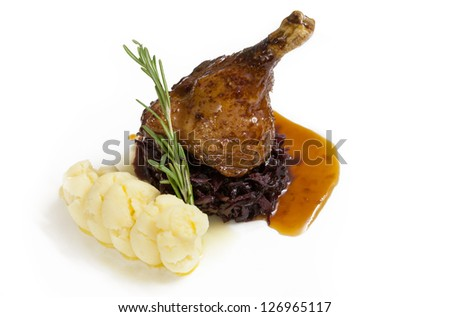 Roasted goose leg with mashed potatoes, beet salad drizzled with honey sauce