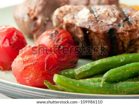 roasted lamb chops with grilled tomato and green beans - stock photo