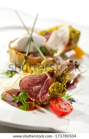 Roasted Lamb Chops with Pistachio. Garnished with Eggplant and Artichoke