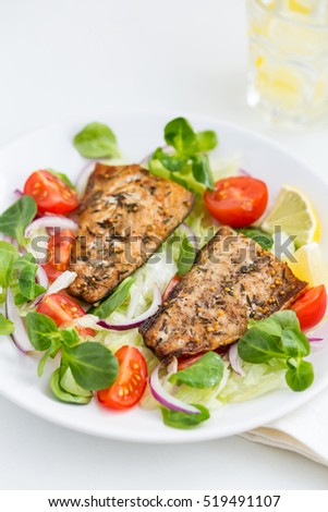 roasted mackerel fish with fresh salad, white background, selective focus