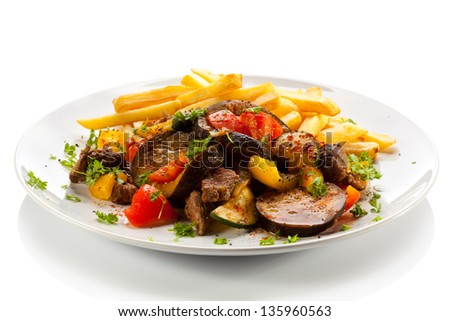 Roasted meat, French fries and vegetables