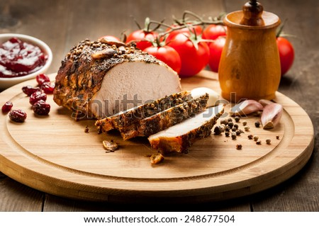 roasted meat on a wooden board - stock photo