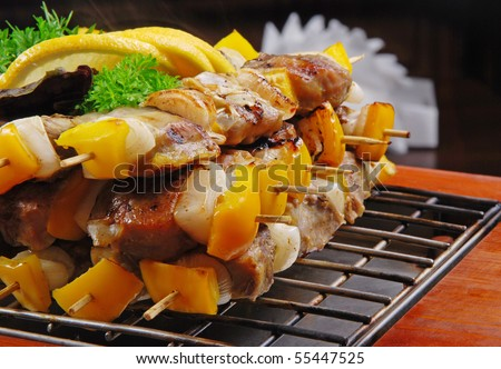 Roasted meat on grill with dark background - stock photo