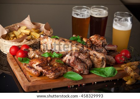 Roasted meat on the grill with beer
