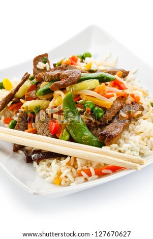 Roasted meat, white rice and vegetables