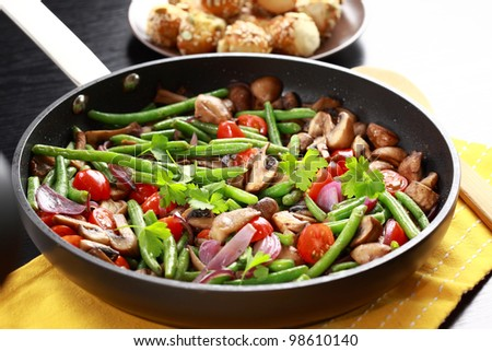 Roasted mushrooms with vegetable in the pan - stock photo