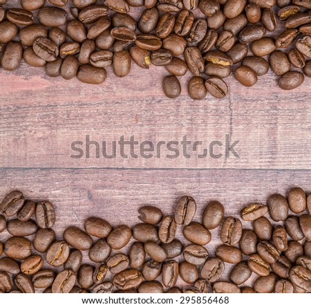 Roasted offee beans over wooden background - stock photo