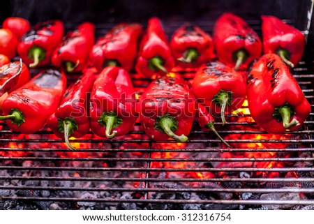 Roasted peppers on the grill - stock photo