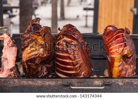 Roasted pig on the spit for a big party - stock photo