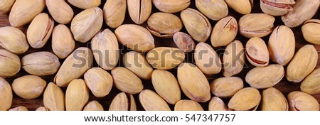 Roasted pistachio nuts as background, healthy food and nutrition