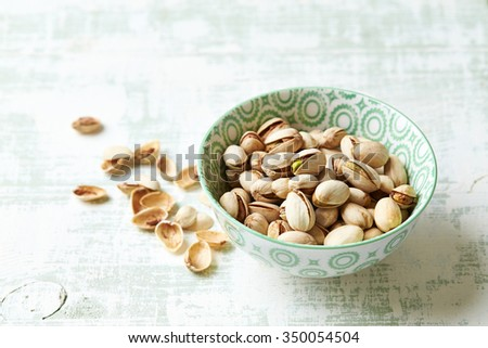 Roasted pistachios in a bowl - stock photo