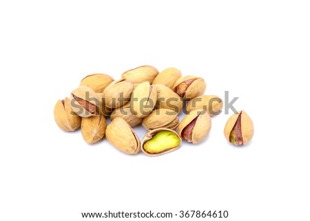 roasted pistachios on a white background - stock photo