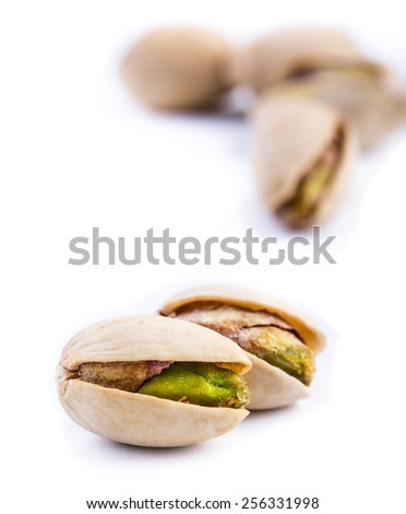 Roasted pistachios on a white background, Macro - stock photo