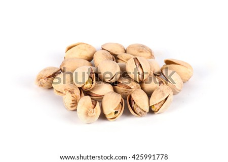 Roasted pistachios on a white background. Roasted nuts - stock photo