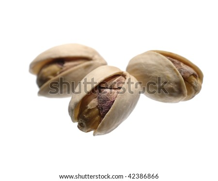 Roasted pistachios on white. Not isolated