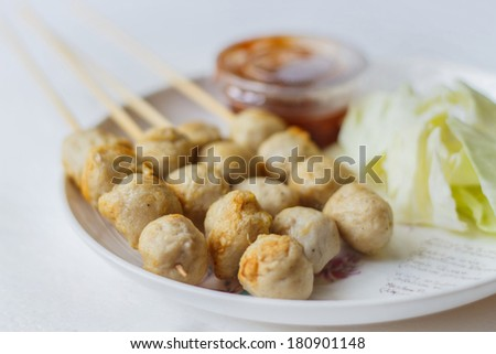 Roasted pork ball with sweet spicy sauce and cabbage