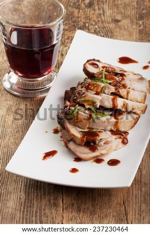 roasted pork dish  - stock photo