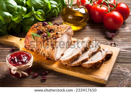 Roasted pork loin with cranberry and rosemary - stock photo