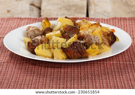 Roasted pork meat with baked potatoes