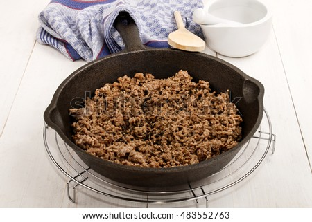 roasted pork mince with crushed peppercorns in a cast iron pan on cooling rack