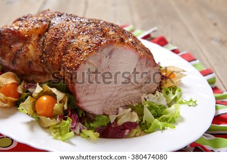 Roasted pork neck with garlic and black pepper - stock photo