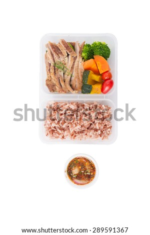 Roasted pork tenderloin with vegetables cooked by clean food concept with brown rice and Northern Thai local sauce isolated on white background with clipping path